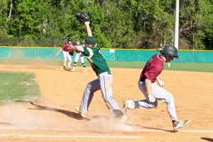 Indy's first baseman Dylan Giorgio gets the Rock Ridge runner at first.