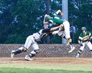 Indy's Michael Menzer tries to avoid the tag from Providence's catcher.