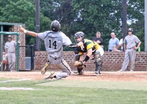 Indy's catcher Cooper Fandel tags out Butler's Tate Pennington at home in Thursday's game against  Butler.