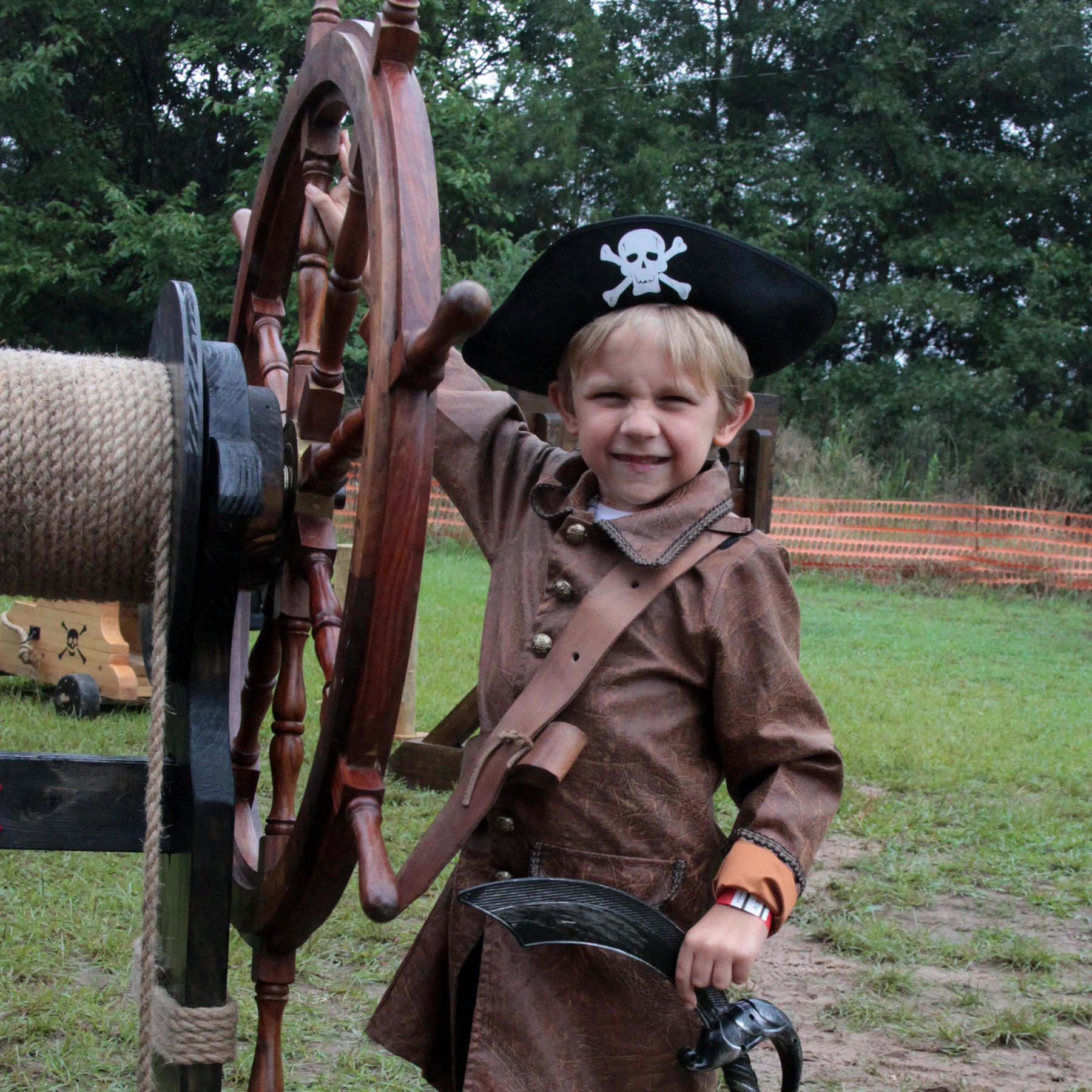 Jack, 6, from Waxhaw, spins Captain Jack's wheel at the Pirate Encampment at the Museum of the Waxhaws in 2019.