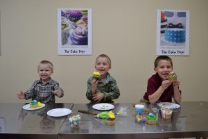 Youngsters eating their cupcake creations at the Cake Dojo