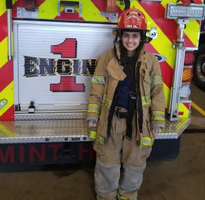 Asha in fire gear by Engine No. 1
