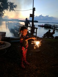 Youngster with sparkler.