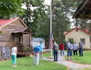 A few trustees and volunteers gathered to lower the flag at the Mint Hill Historical Society in his honor