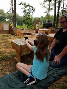 Girl shooting in ECHO Training's kids' class