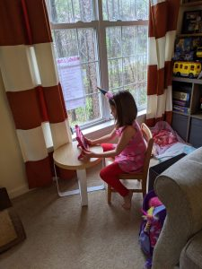 Young girl completes remote learning on a Kindle Fire Kids