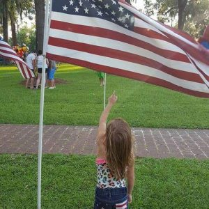 A Young Girl Honoring Old Glory.