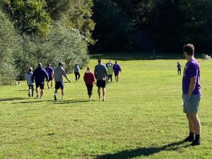 Team walking around farm during event.