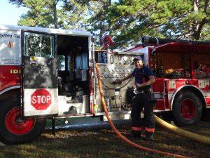 Firemen Manning Pumper Truck Console.