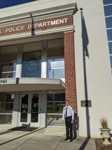 Chief Ledford in front of Mint Hill Police Department.