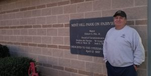 Mr. Ron Tanner standing in front of facility center at park
