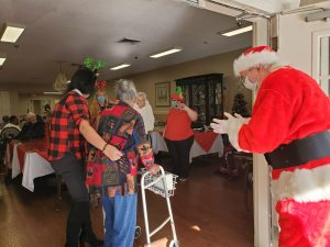 A masked Santa Claus played by Bonnie's husband Rex greeted residents from the patio.