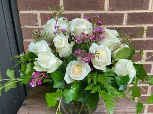 Rose display with multiple types of flowers