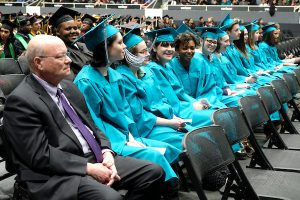 Levine Middle College High School principal Joey Burch with his graduates