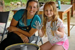 Getting a little muddy is what campers love at the Pottery Wheel Throwing Summer Camp at the Art Box