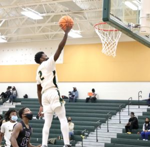 Jalen Hinton scores 2 of his 14 points in Tuesday's game against Porter Ridge.