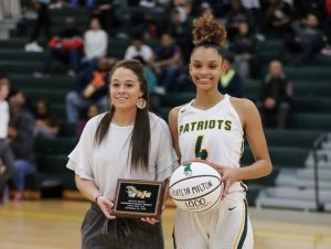 Braylyn Milton with Coach Galvani achieving the 1000 point plateau. (Photo by Ron Morris)