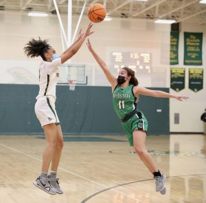 Indy's Braylyn Milton scores over a Myers Park defender.