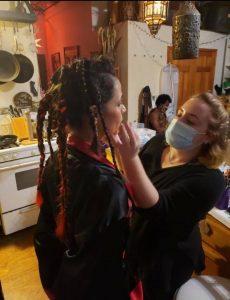 Paige Rabinowitz applying makeup on set during the pandemic