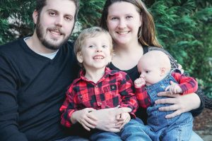 Kayla Duehring with her husband and sons PJ and Hunter