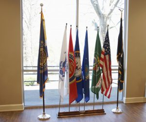 Old Glory, Service Branch Flags, POW-MIA Flag, and American Legion Flag in Dinning Room.
