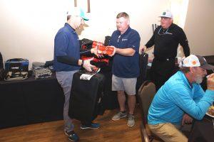 Steve Baucom and Bryan Bunn Hand Out a Raffle Prize.
