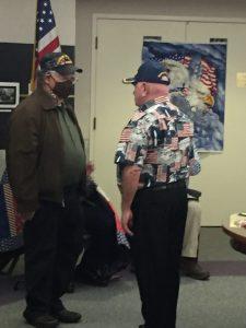 George Davis receives his Vietnam War Lapel Pin from Mr. Mayhill.