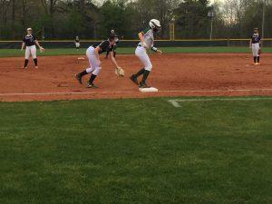 Megan Invester makes nice pop up slide into third base.