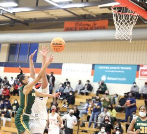 Braylyn Milton scores 2 of her 22 points. Photo by Ron Morris