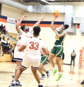 Indy's Jessica Timmons scores against two Vance defenders. Photo by Ron Morris