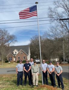 Shift C at Mr. Long's standing in front of flagpole.