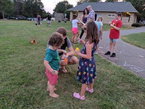 Children blowing bubbles at the park