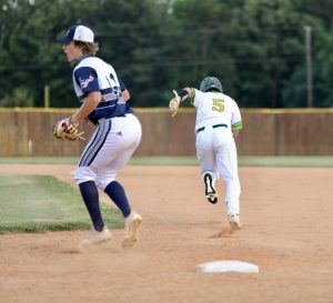 Luke Chantry steals second. Photo by Ron Morris