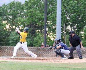 Wilson Lohrer drives the ball into left field in Indy's win over East Mecklenburg. Photo by Ron Morris