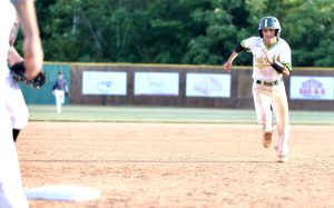 Sam Merli steals third in Thursday's home game against Butler. Photo by Ron Morris.