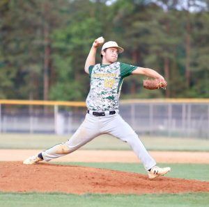 Zack Francis fires home during the doubleheader at Purnell Swett High School. Photo by Ron Morris