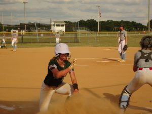 Abi Sawyers slides safely into home plate.