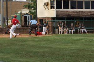 Post 555's Dwight Girrard is out at home plate.