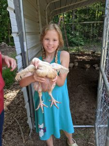 Sophie holding a young meat bird