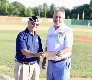 Mint Hill American Legion Commander Ed Berti presented Mint Hill Mayor Brad Simmons with a plaque of appreciation.  Photo by Ron Morris.