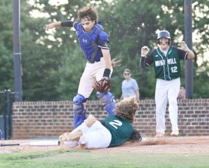 Ick Cirino is safe at home in Mint Hill's win over Queen City.  Photo by Ron Morris