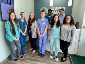 (LtR) Part of the staff at the Passionate Paws Waxhaw Office.  Front row: Tatyana Cain, Emily Gaji, Stacy Rolph, Dana Palmer, Dr. Bonilla, and Julia.  Back row: Mac Jones and Stephen Bonilla.