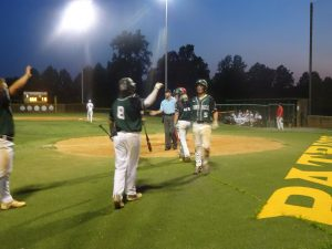 Adam Wilkerson receives high 5's from teammates.