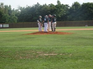 Mound meeting in nightcap. Wilson Lohrer pitched 5 shut-out innings before allowing a run.