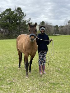 Teenage girl with horse