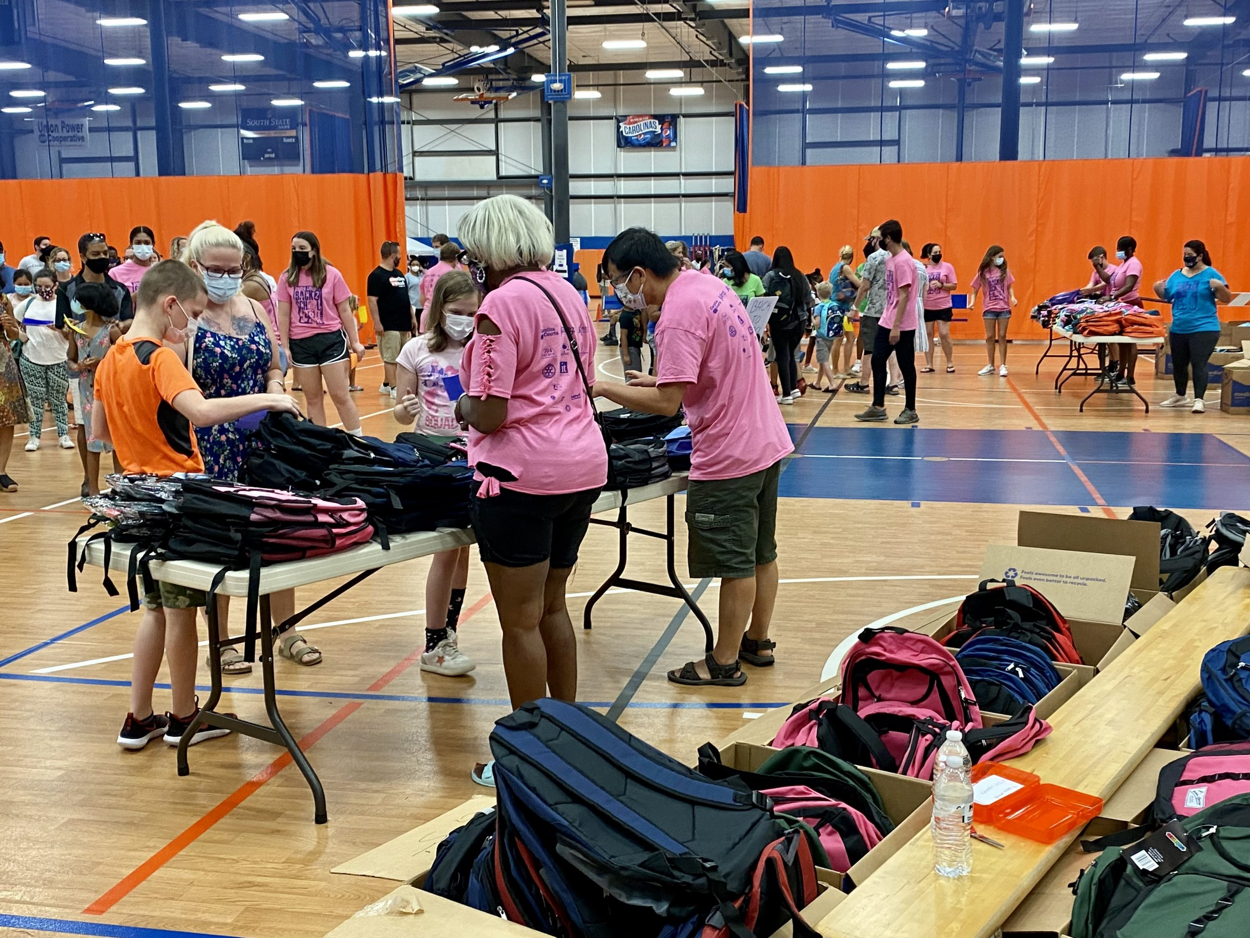 Boxes of backpacks wait to be distributed at the Union County B2SB held in Carolina Courts in Indian Trail.