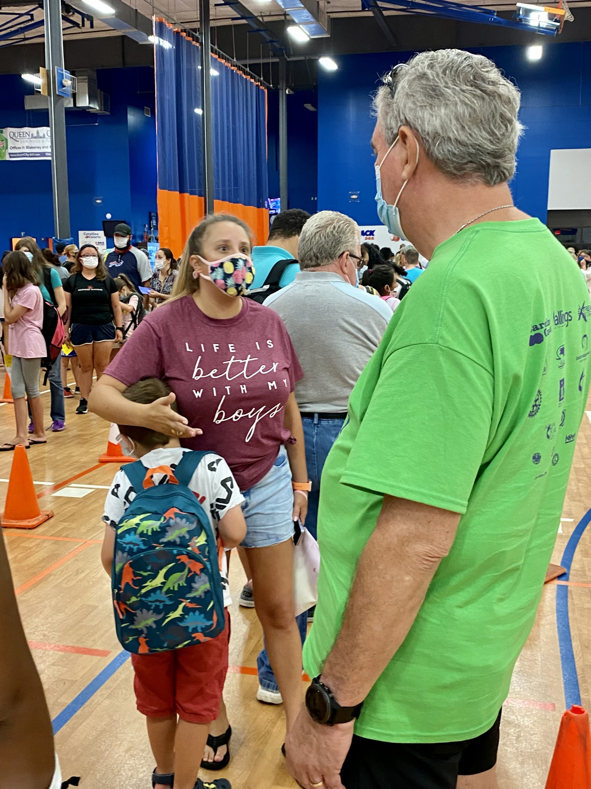 Katy Brooks and her son, Joey, speak to Pastor Ireland at the Union County Back 2 School Bash.