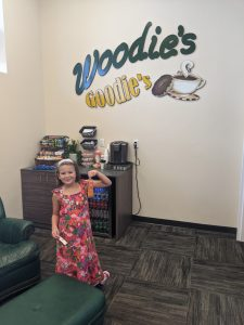"""Customers enjoy """"Woodie's Goodies"""" in a comfortable waiting room while their car is serviced."""