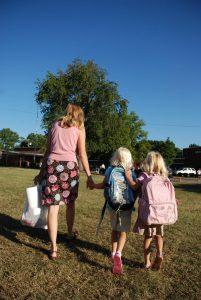 Mother walking children to school