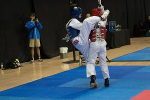 Avery (in blue on left) sparring at the AAU Taekwondo Nationals in Las Vegas.